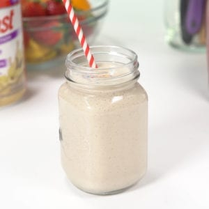 Frosted Sugar Cookie Smoothie in a mason jar glass.